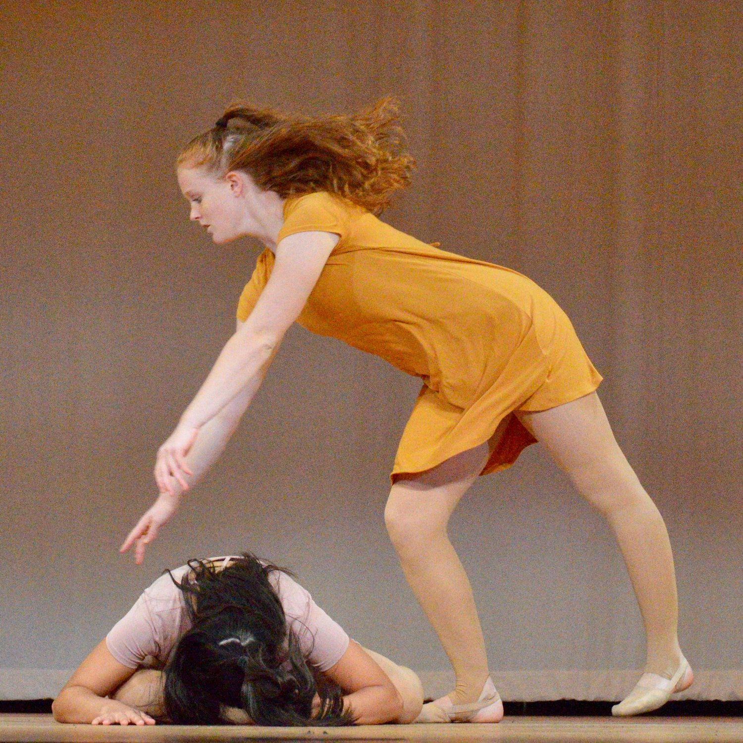 Alison Smart (in yellow) and Kerrin Bulpett run through a dance routine during a rehearsal for the cabaret at Portsmouth High School.