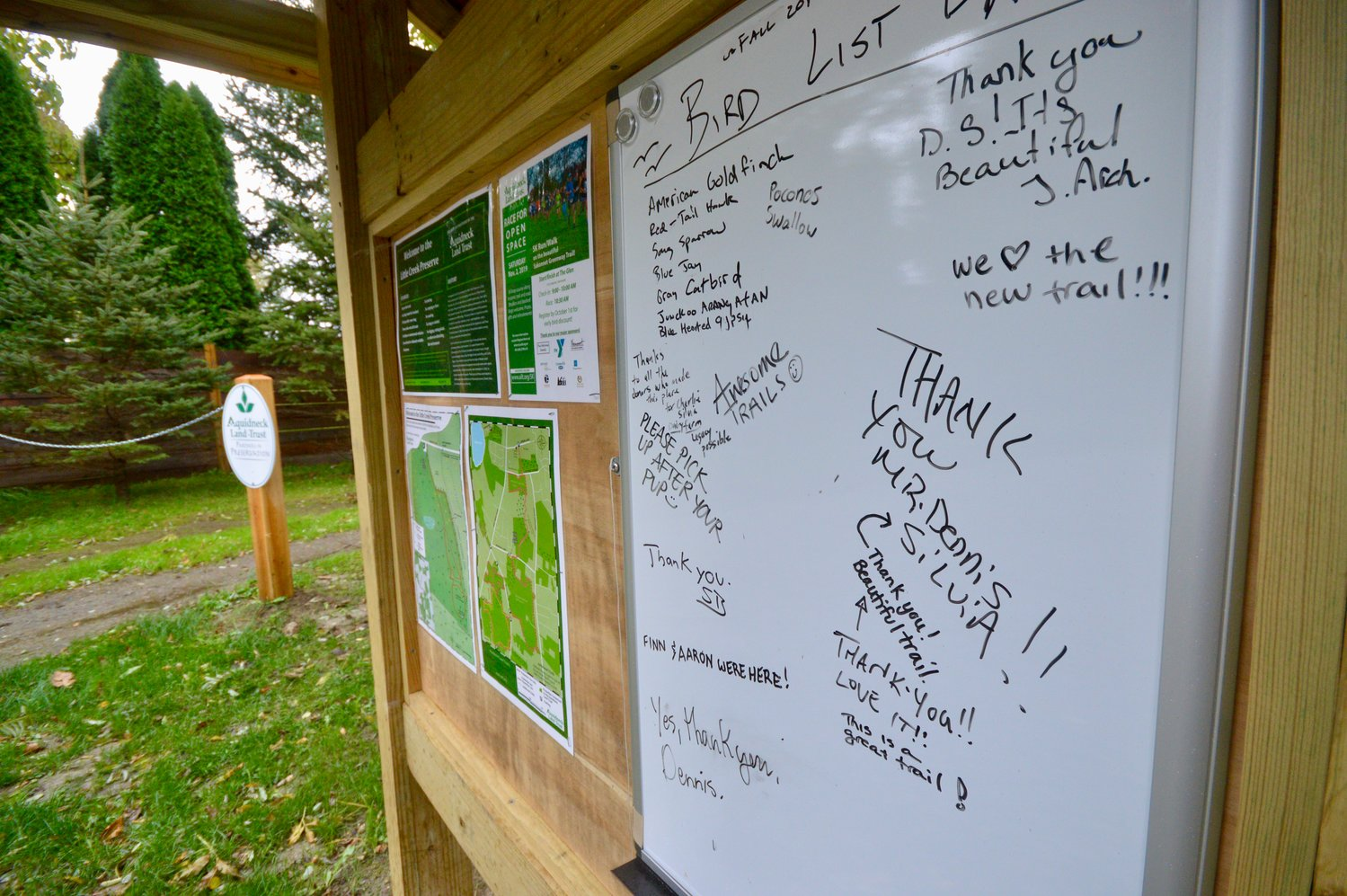A message board at the entrance of Little Creek Preserve includes messages of thanks to previous owner Dennis Silvia.