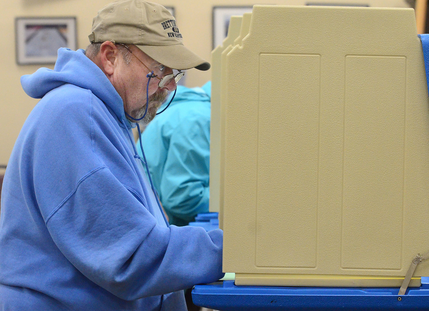 Joseph McGreavy votes during the election at Tiverton Town Hall on Thursday.