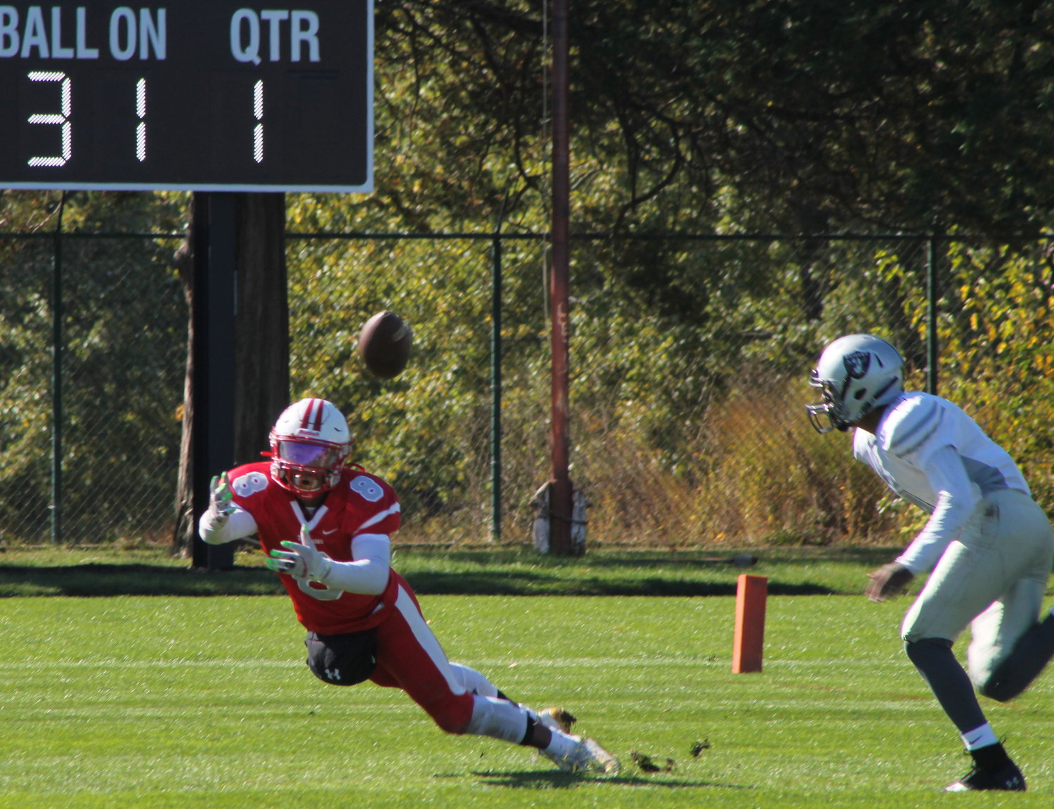 Jahad Davis Pinto dives to make a catch to set up a Townie touchdown against the Raiders.