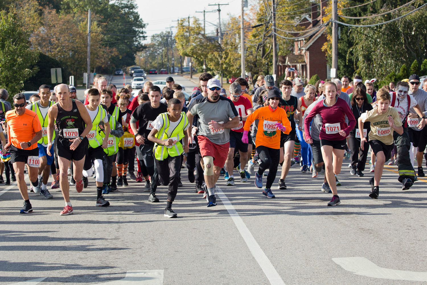 Runners take off at the start of the East Providence Firefighters Freaky 5k, on Sunday.