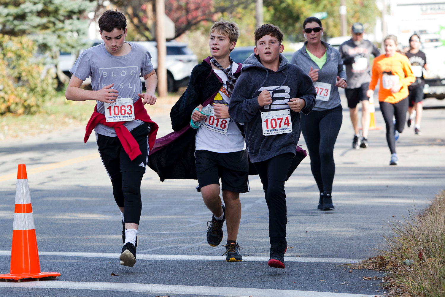 Brayden Rouette, Trent DeCosta, and Stephen Sorrentino run down Wilson Avenue while participating in the East Providence Firefighters Freaky 5k, Sunday.