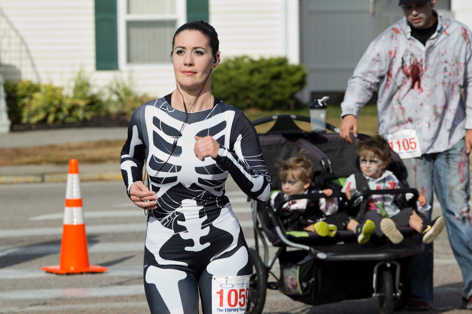 Nicole Paynich runs toward the finish  line of the East Providence Firefighters Freaky 5k, Sunday.