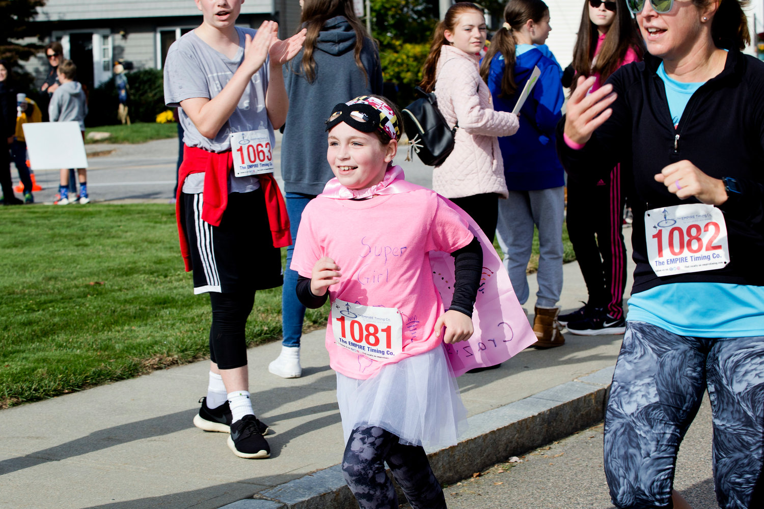 Caroline Welch races toward the finish line of the East Providence Firefighters Freaky 5k, Sunday.