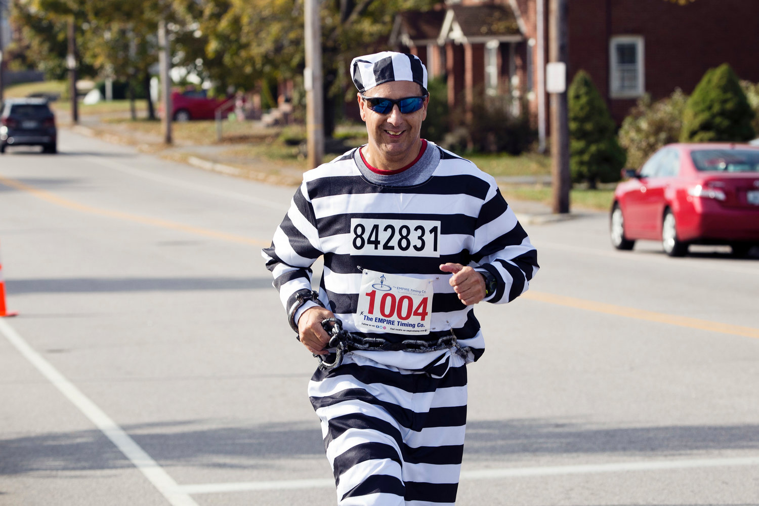 Jesus Berrio runs up Broadway while participating in the East Providence Firefighters Freaky 5k, Sunday.