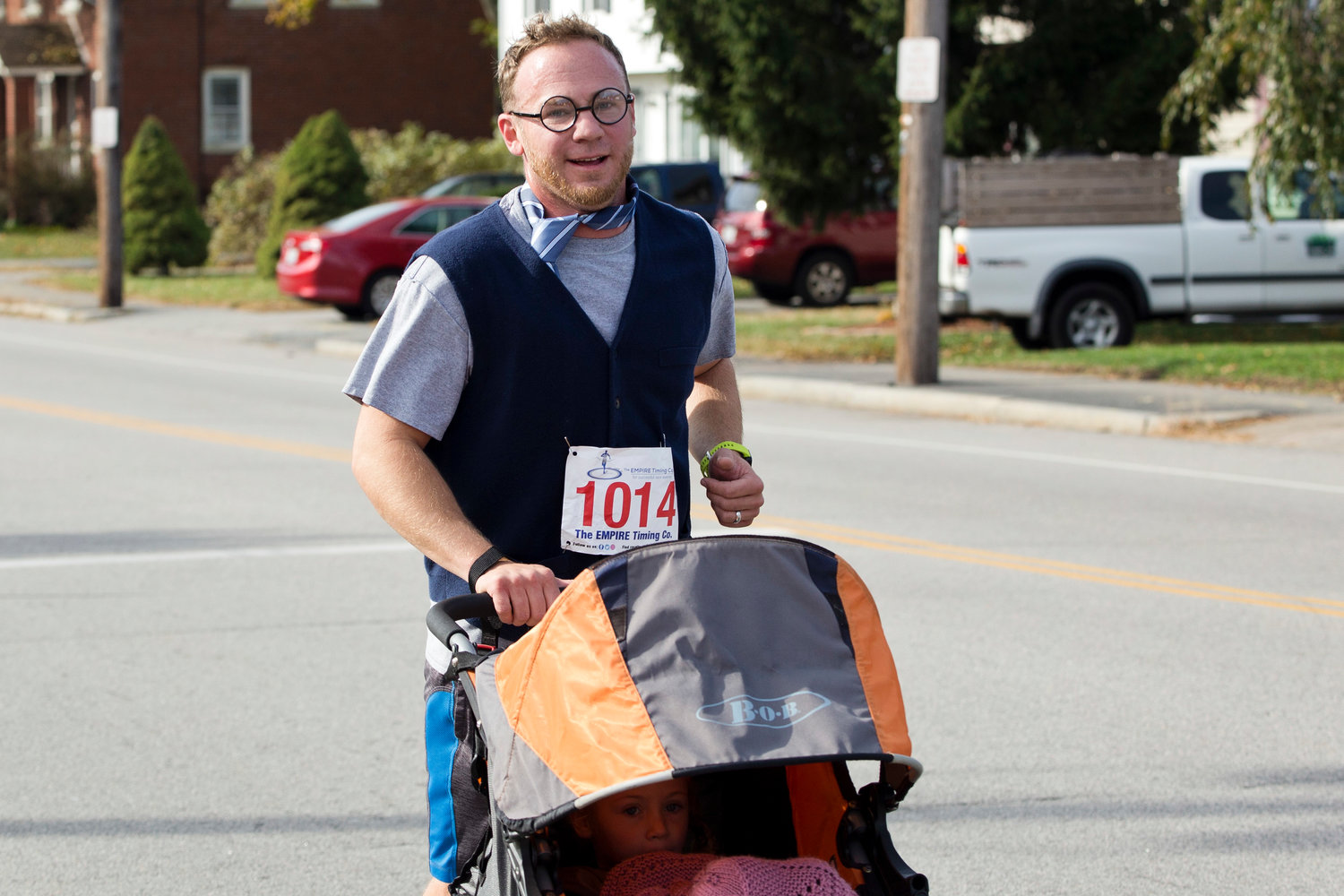 Riverside Middle School cross-country coach Brandyn Chace races toward the finish line dressed as Harry Potter while participating in the East Providence Firefighters Freaky 5k, Sunday.