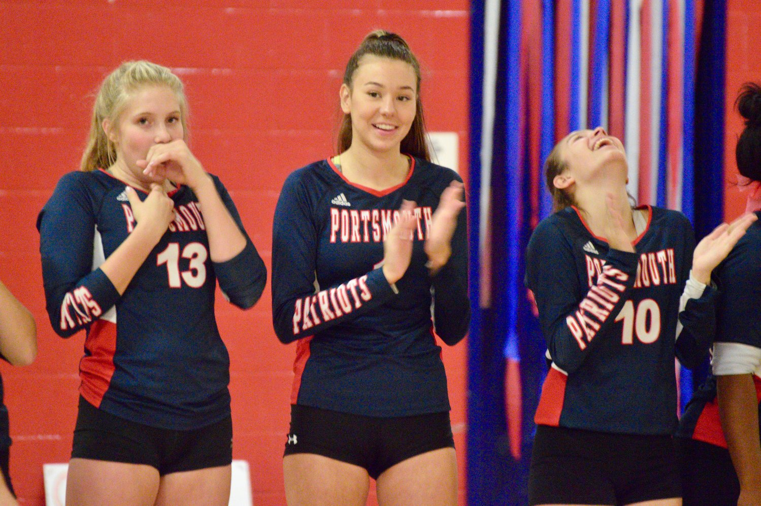 Tatum Horley, Morgan Shablom and Julia Durant (from left) applaud during the introductions Monday night.