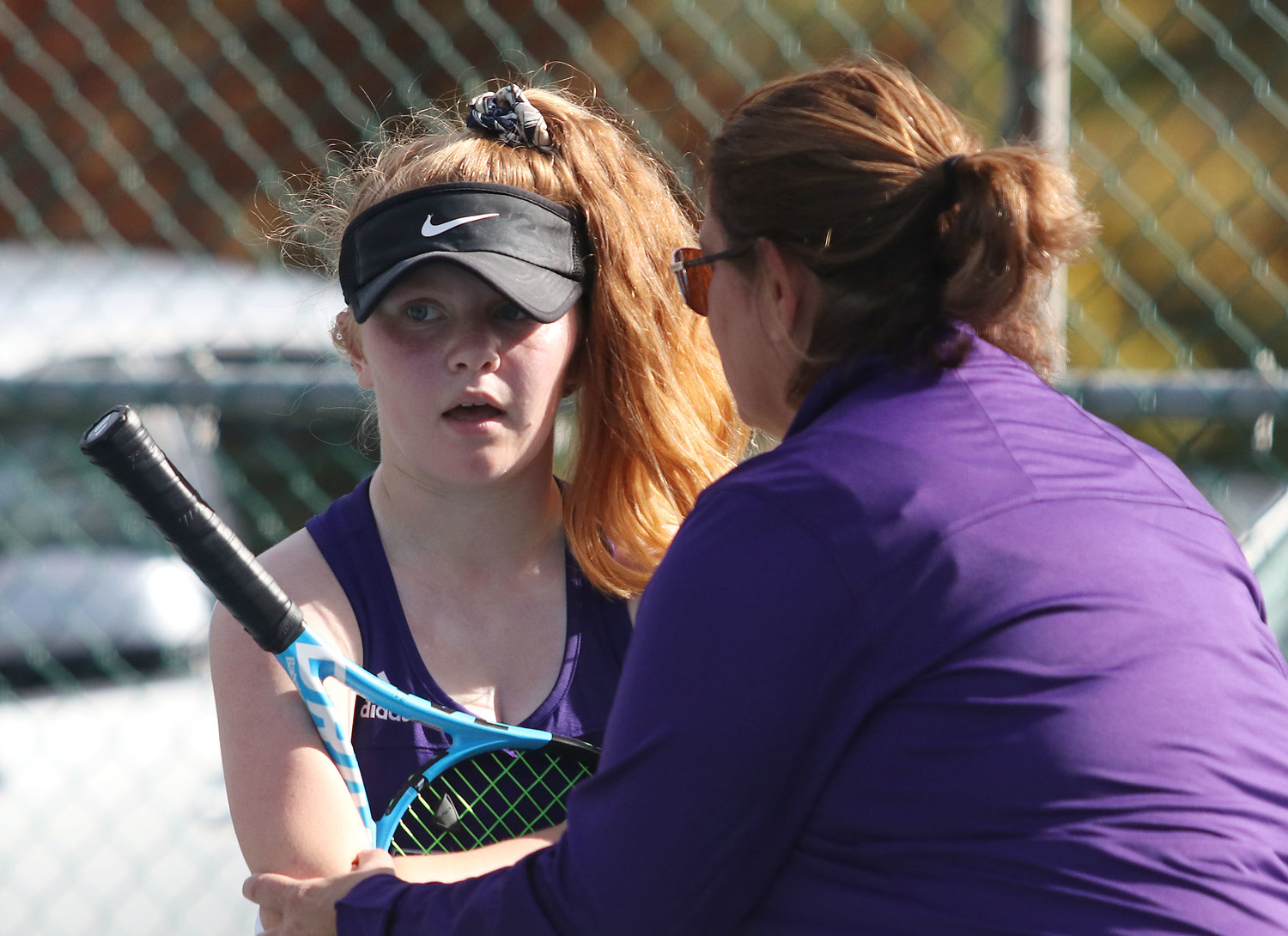 Assistant coach Maureen Gauthier rubs Meg Dolan's elbow between sets after she hurt it during early in the match.