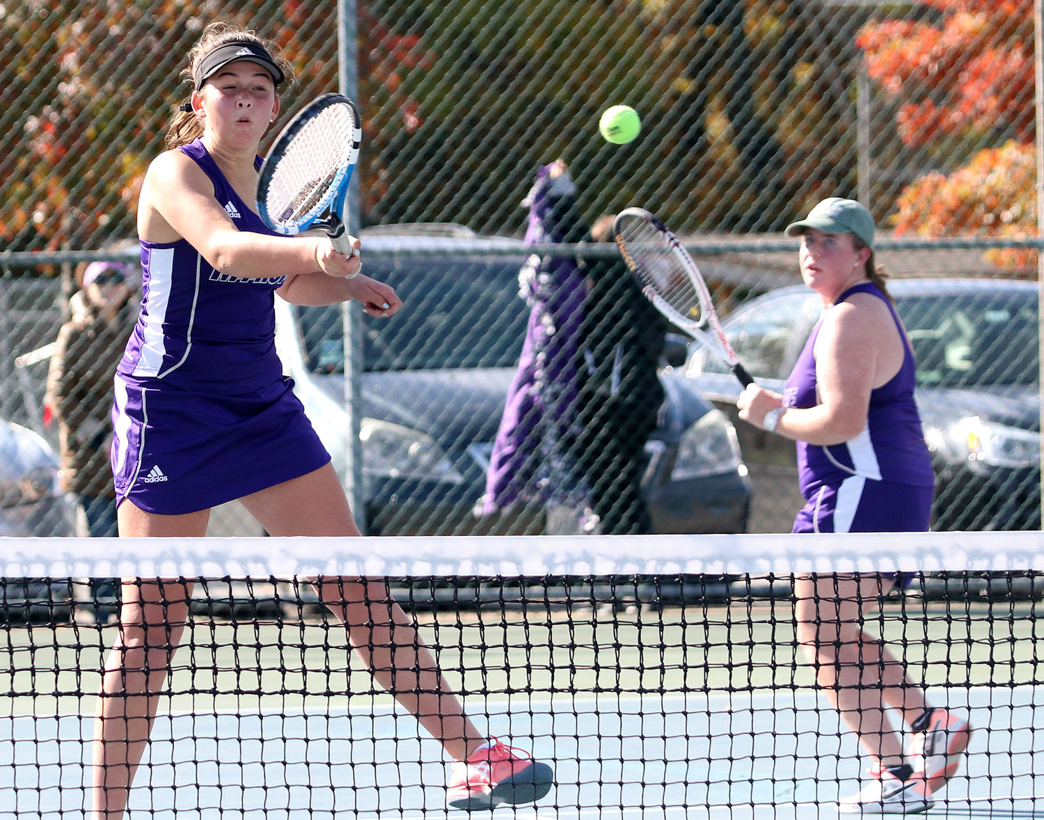 Annie Kryzwicki (left) hits a volley with No. 1 doubles partner Ellee Kopecky.
