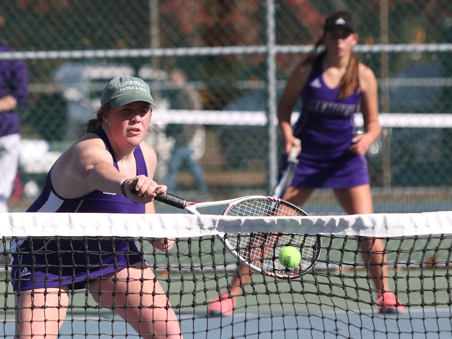 Elle Kopecky (left) hits a volley at the net with No. 1 doubles partner Annie Kryzwicki.