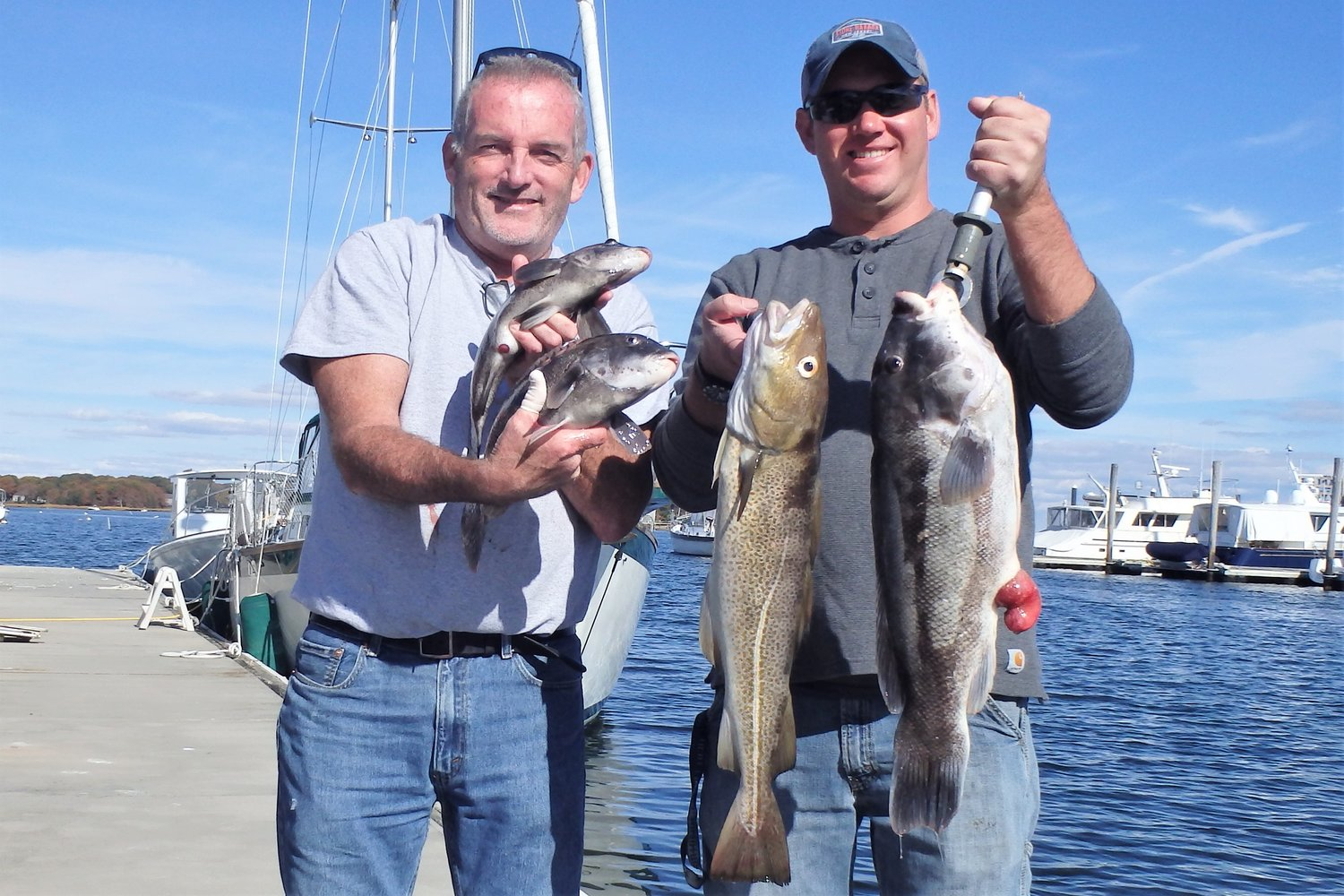 Dave Bonney, Barrington and Peter Roche, Stratford, CT with the some of the ten tautog and cod they caught when fishing off Newport.