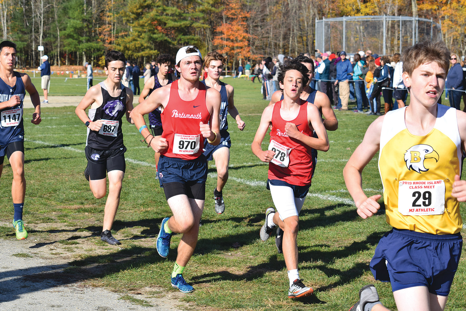 The Patriots' Declan Foster (center left) and Tanner McHugh (right) compete in the Class B cross-country championship at Ponaganset High School on Saturday.