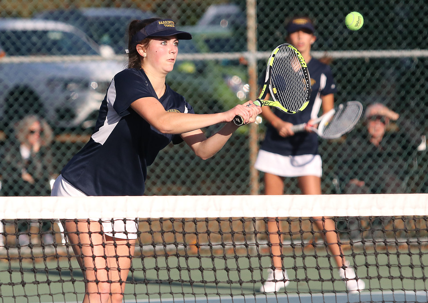 Barrington's Lauren Jay returns a shot during the second doubles match at the state finals on Saturday. Lauren and Sonya Pareek are Barrington's second doubles team.