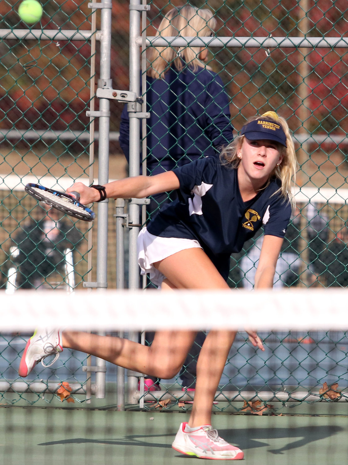 Barrington's Kate Robertson hits a shot during the second singles match at the Division I state finals on Saturday.