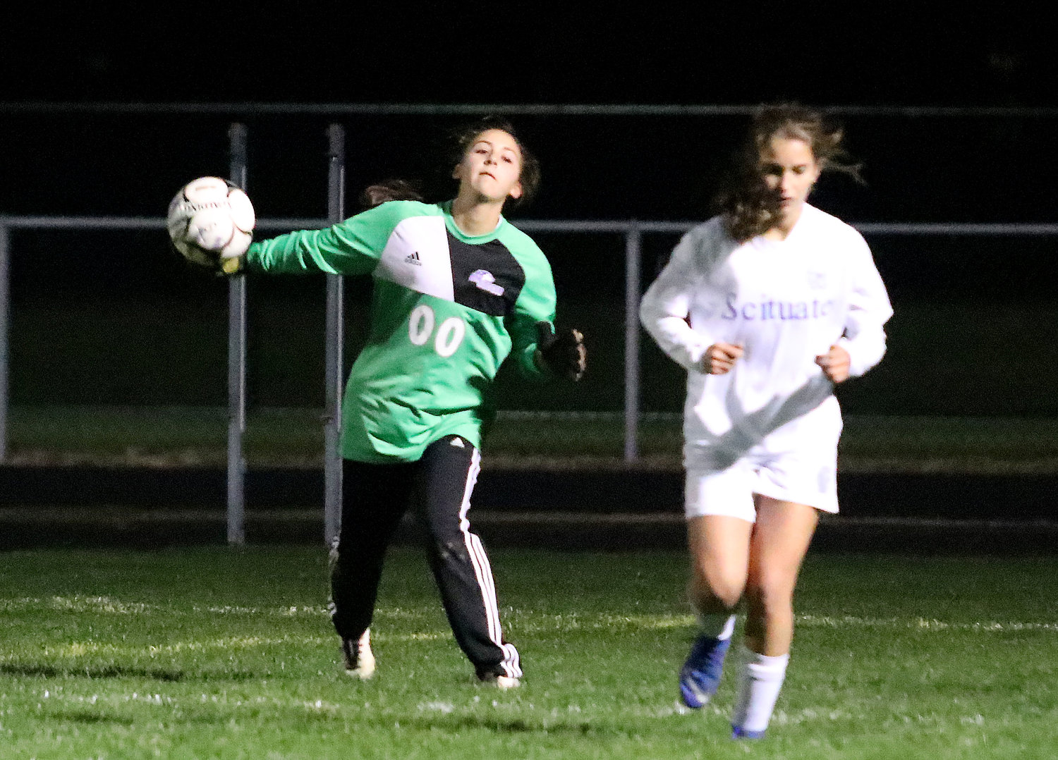 Huskies goalkeeper Logan Levesque throws the ball up field.