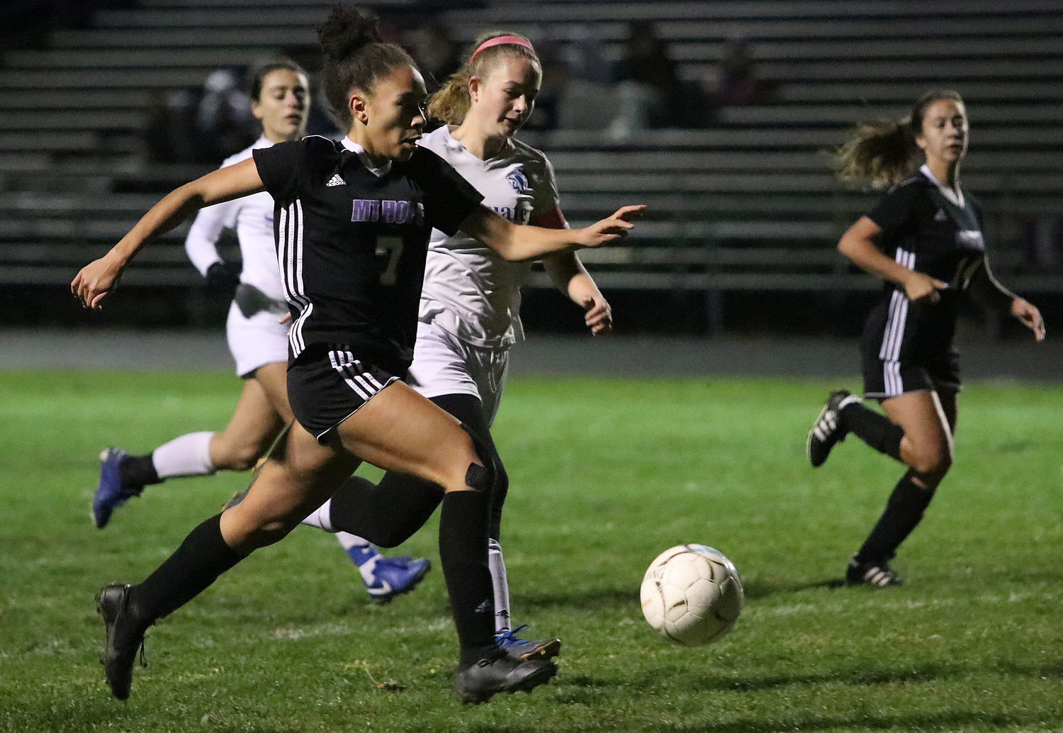 Angela Lee speeds by a defender for a scoring chance in the first half. She scored the Huskies first goal of the game.