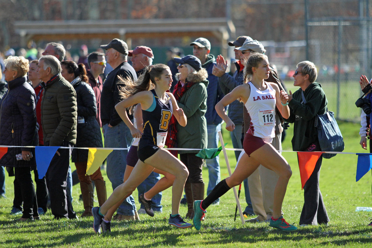 Barrington High School's Caroline Livingston runs a step behind LaSalle's Kayle Armitage during the state cross country meet on Saturday.