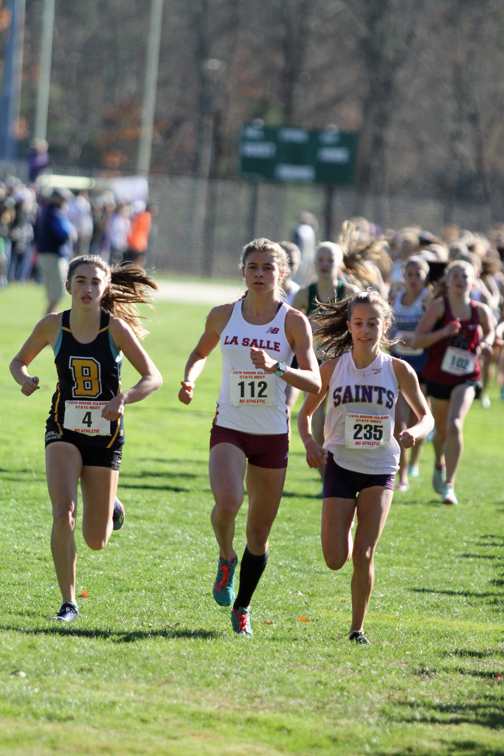 Barrington's Caroline Livingston (left) finished second at the state cross country meet on Saturday.