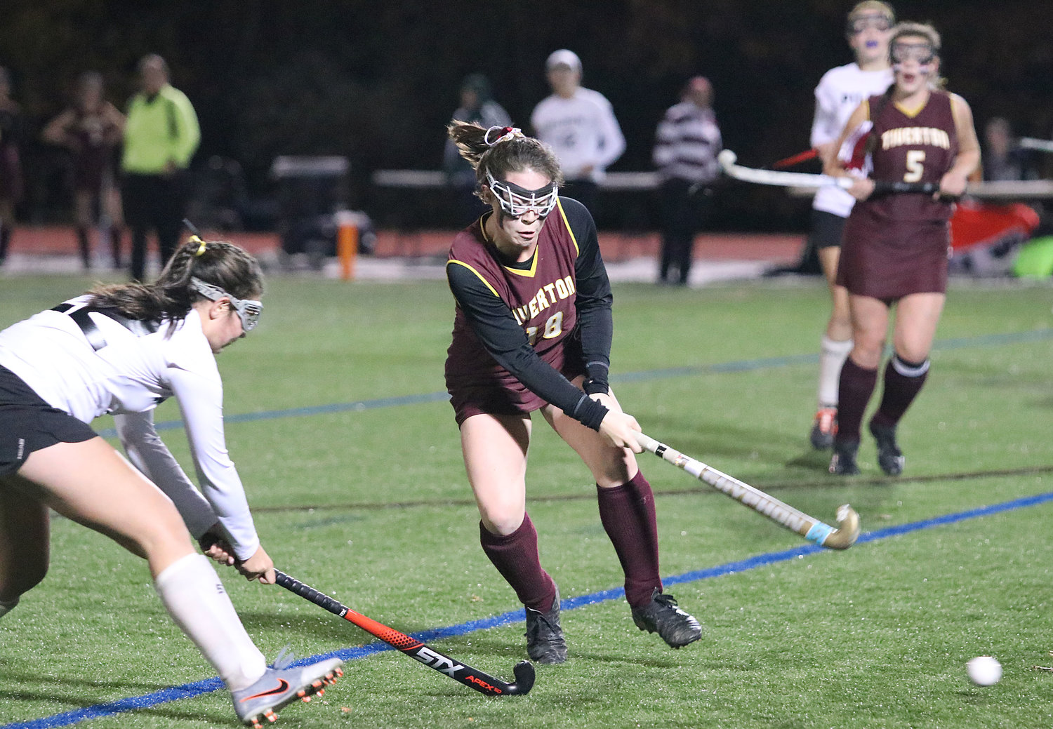 Elise Flanagan battles against a Pilgrim player for the ball during Sunday's Division III state championship game. Flanagan would score Tiverton's lone goal in their 3-1 shootout loss to the Patriots.