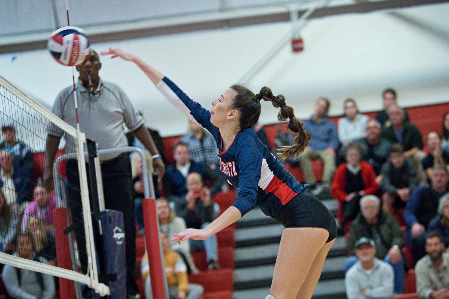 Morgan Shablom fires the ball over the net.