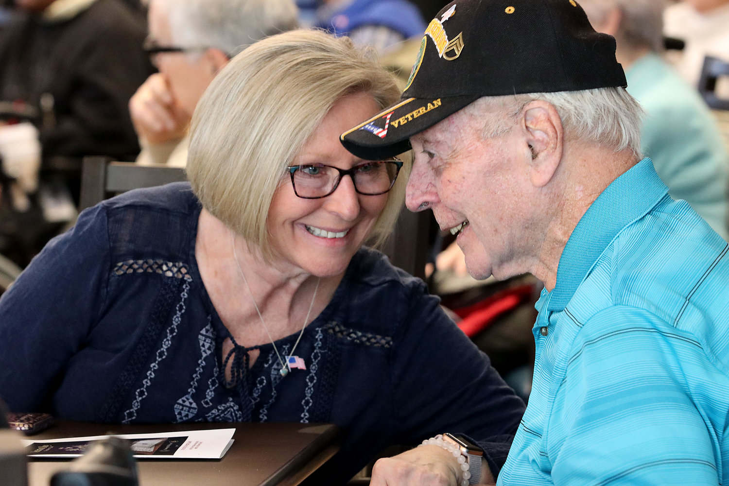 Diane Hamer shares a moment with her dad, Vietnam veteran Tom Roy during the annual Veteran's Day ceremony at the Rhode Island Veteran's Home in Bristol on Monday.