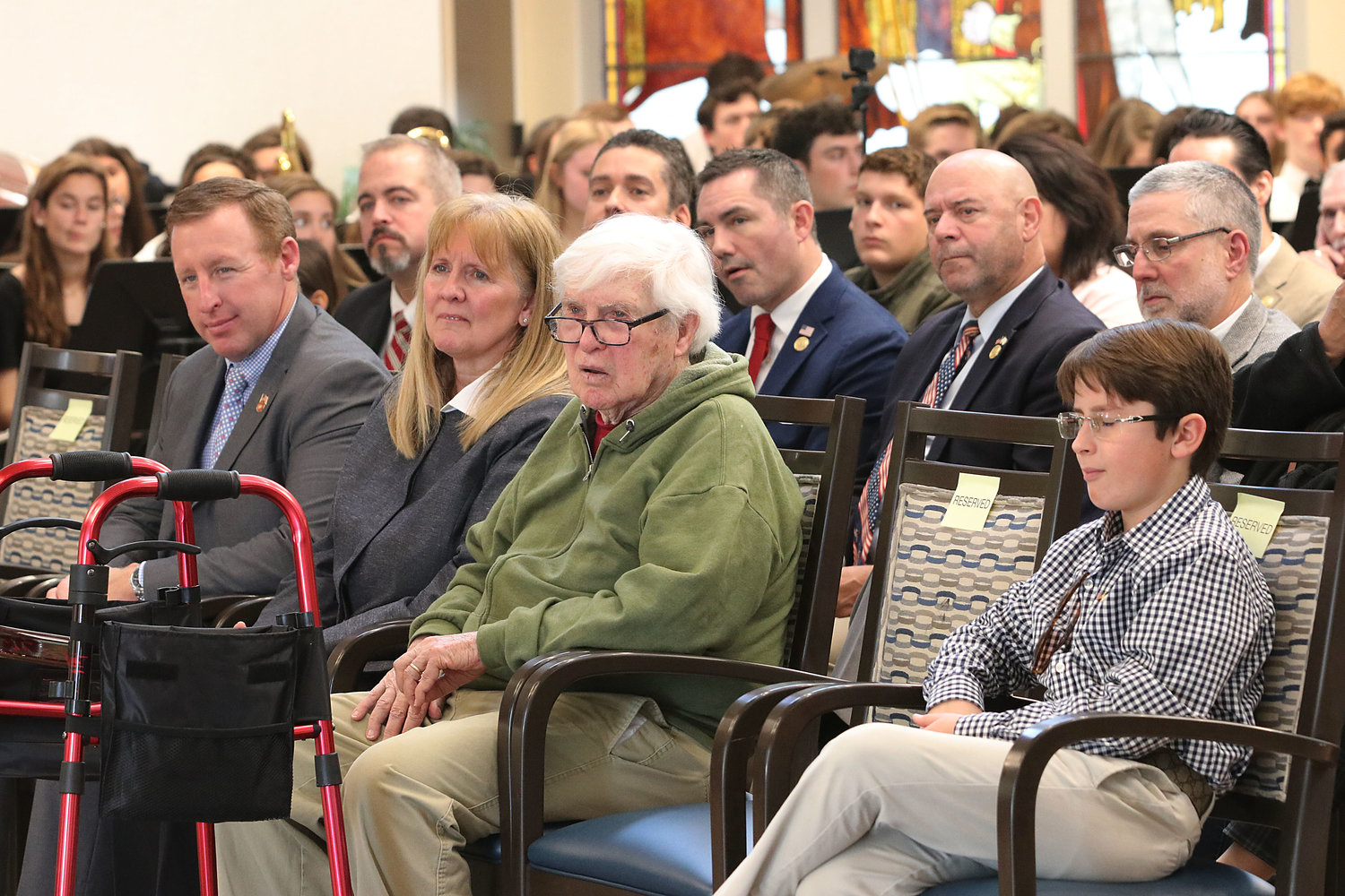 Veterans and politicians look on during the ceremony.