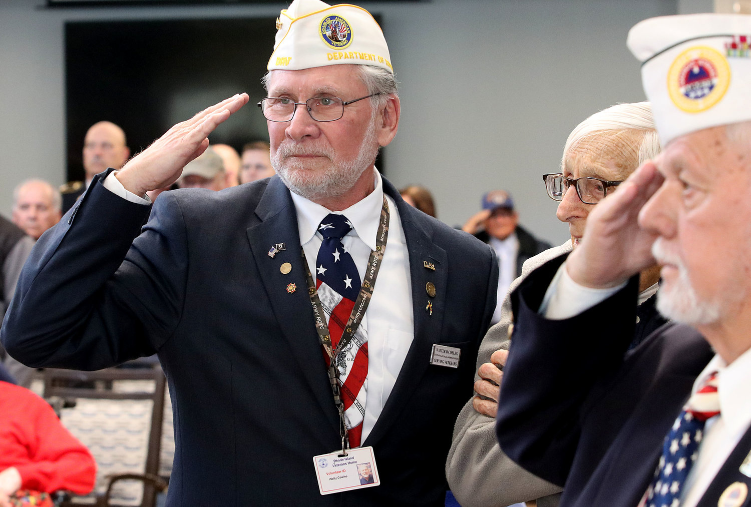 Bristol Veteran's Council President Walter Coelho (left) salutes the flag during the National Anthem.