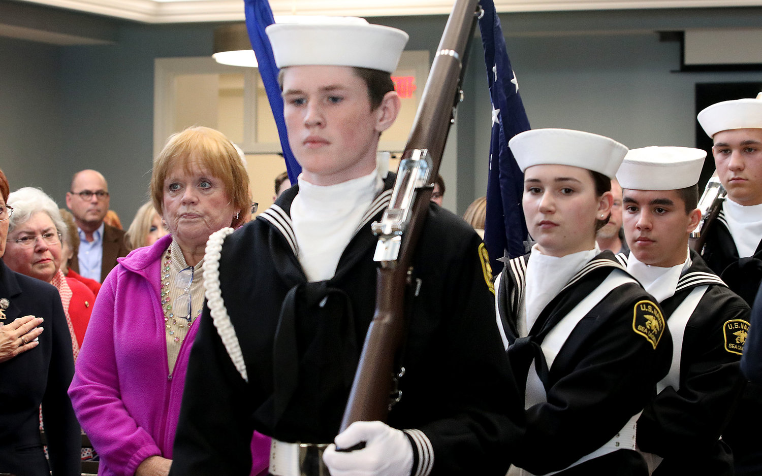 The US Naval Sea Cadets Corps, Falcon Division post the colors for the service.