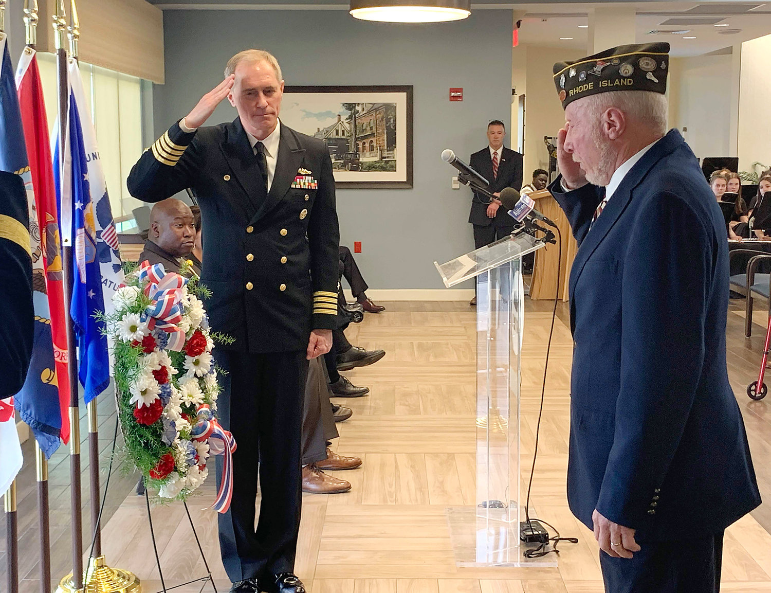 Captain Michael Coughlin (left) and XXX salute the memorial wreath after laying it during the ceremony.