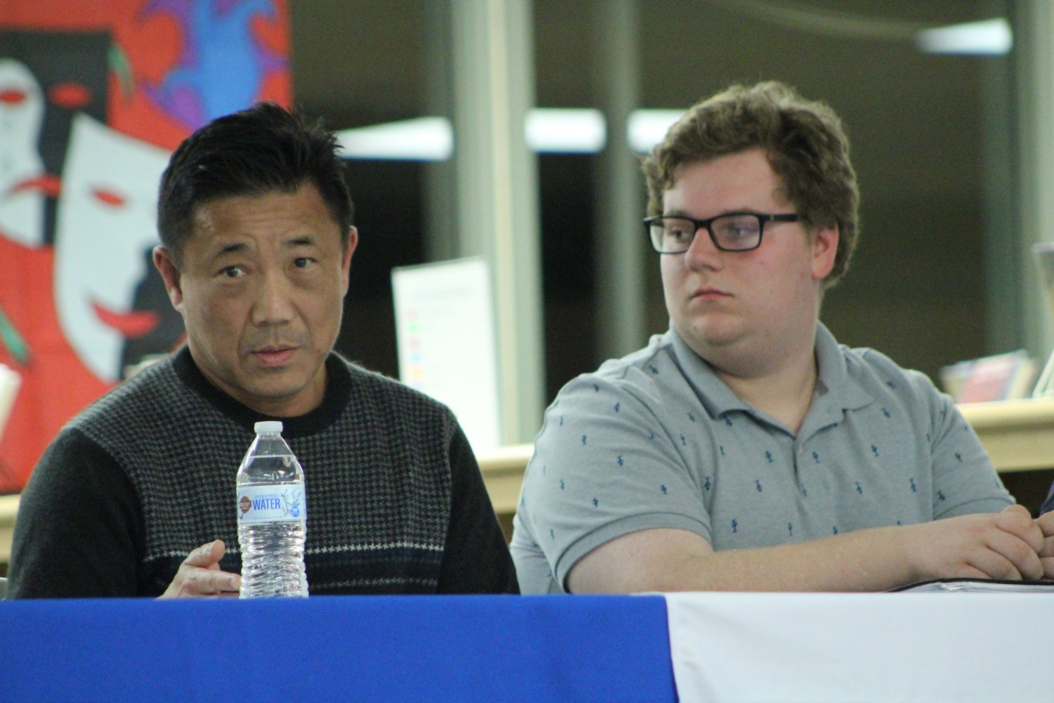 Dr. James Chen (left), a Portsmouth resident and urgent care physician, and Mt. Hope High School senior and Tobacco 21 advocate Sean Palumbo share their knowledge on the vaping crisis during a panel discussion at the Portsmouth Middle School library on Thursday, Nov. 7.