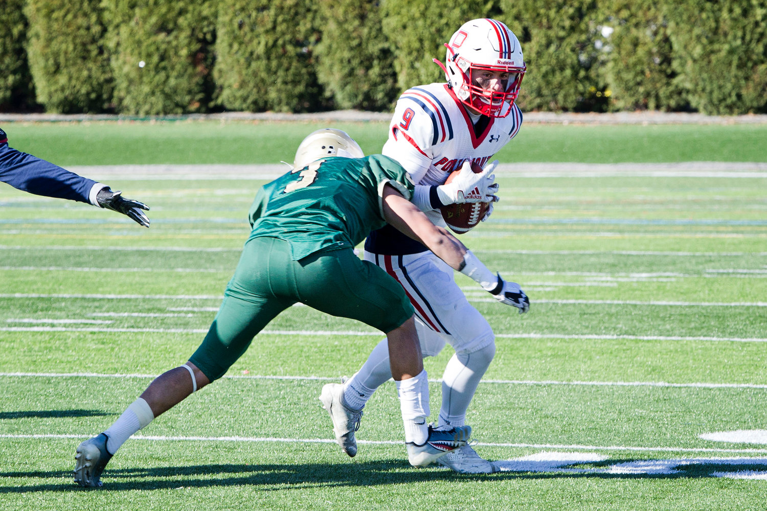 Christopher Bulk attempts to run past a Hendricken defender.