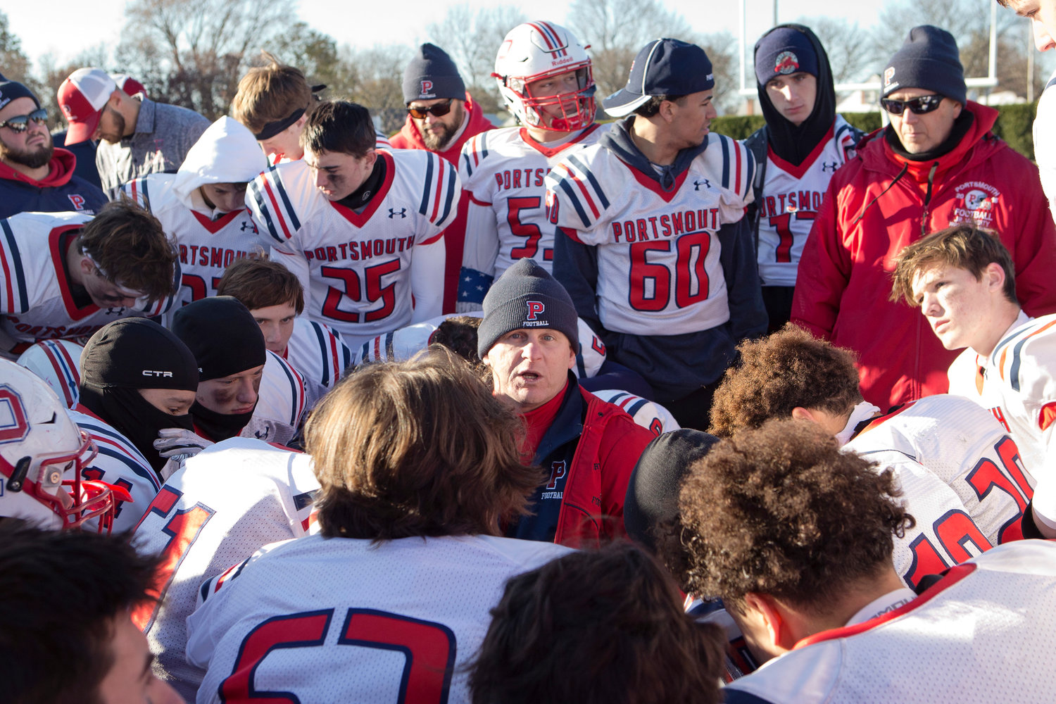 Head coach Dustin Almeida talks with his team after falling to Bishop Hendricken, 35-8, in the Division I Super Bowl on Saturday.