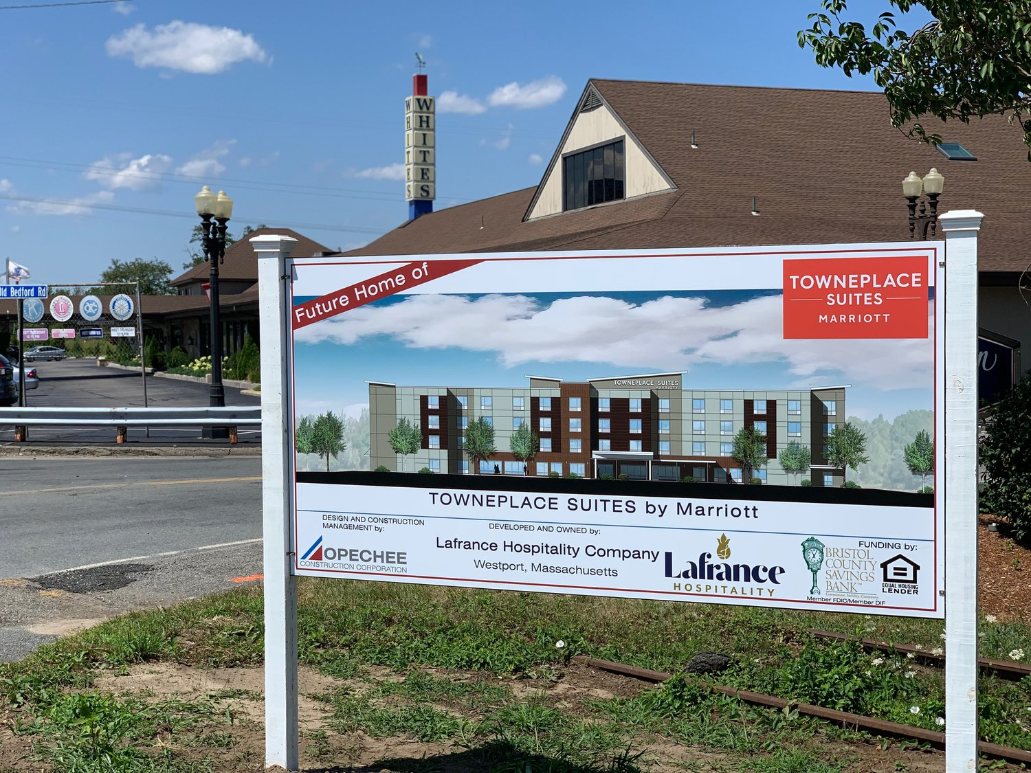 Sign announces the future home of Towneplace Suites by Marriott.