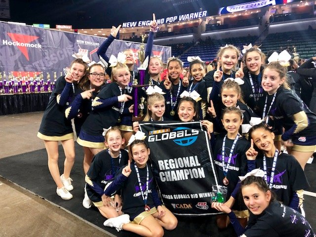 Members of the Barrington Pop Warner JV cheer team celebrate their recent victory at regionals. The JV team will next compete for a national championship on Dec. 11.
