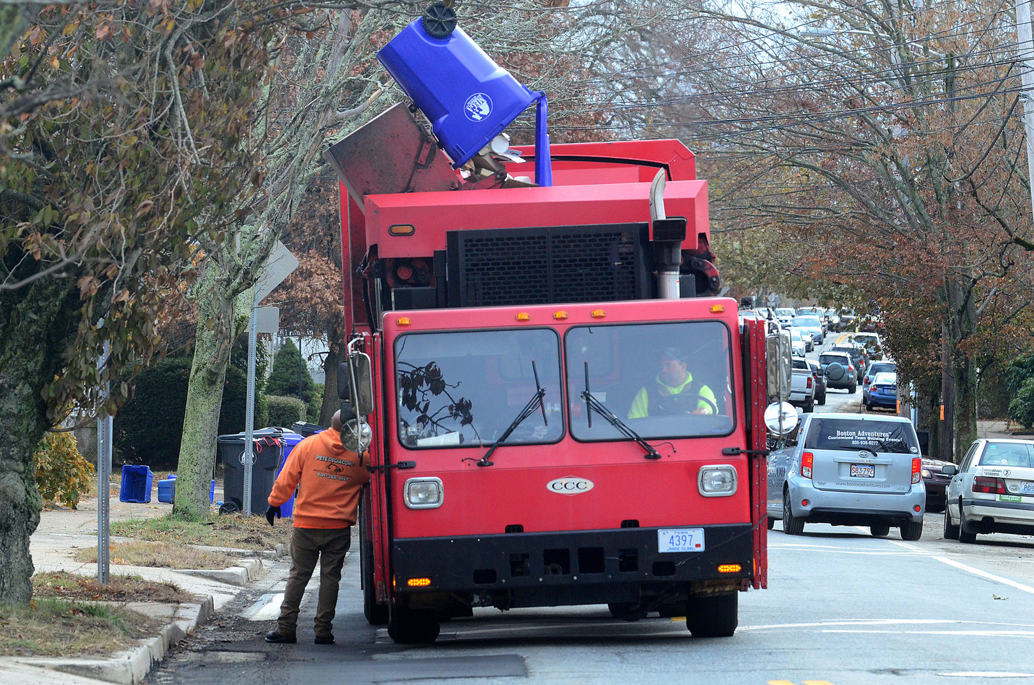 A crew from Mega Disposal empties some of the new bins along Main Street in Warren on Tuesday.