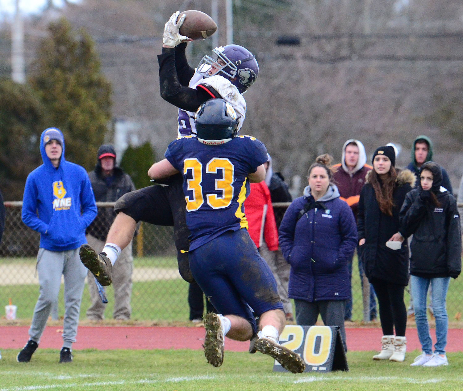 Huskies running back Corey Grifka attempts to catch a pass from Ramaglia in the second half.