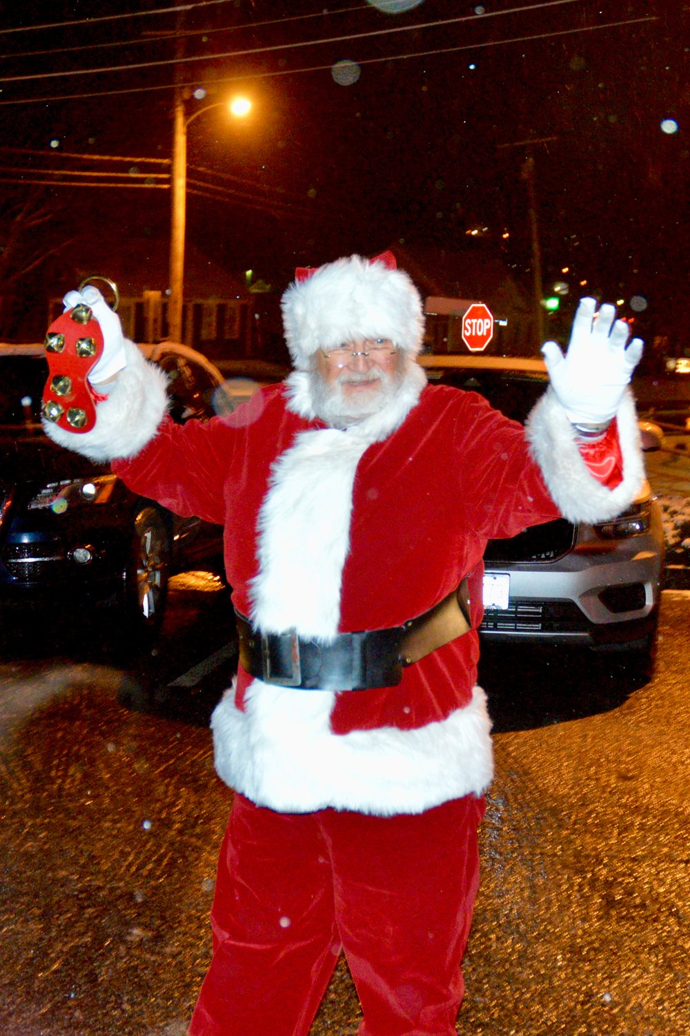 Santa Claus greets his fans after having arrived via fire truck to the Portsmouth Free Public Library Sunday night. He then led the crowd in a countdown of the lighting of the Christmas tree.