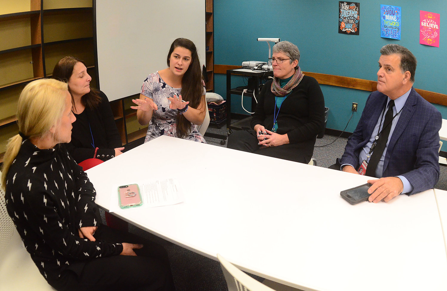 Discussing tech integration at the middle school recently are (from left) Nicole L'Etoile of Rhode Island Association of School Principals; Michelle Michno, Portsmouth Middle School support specialist; Sarah DelSanto, PMS tech integration specialist; and Joao Arruda, PMS principal.