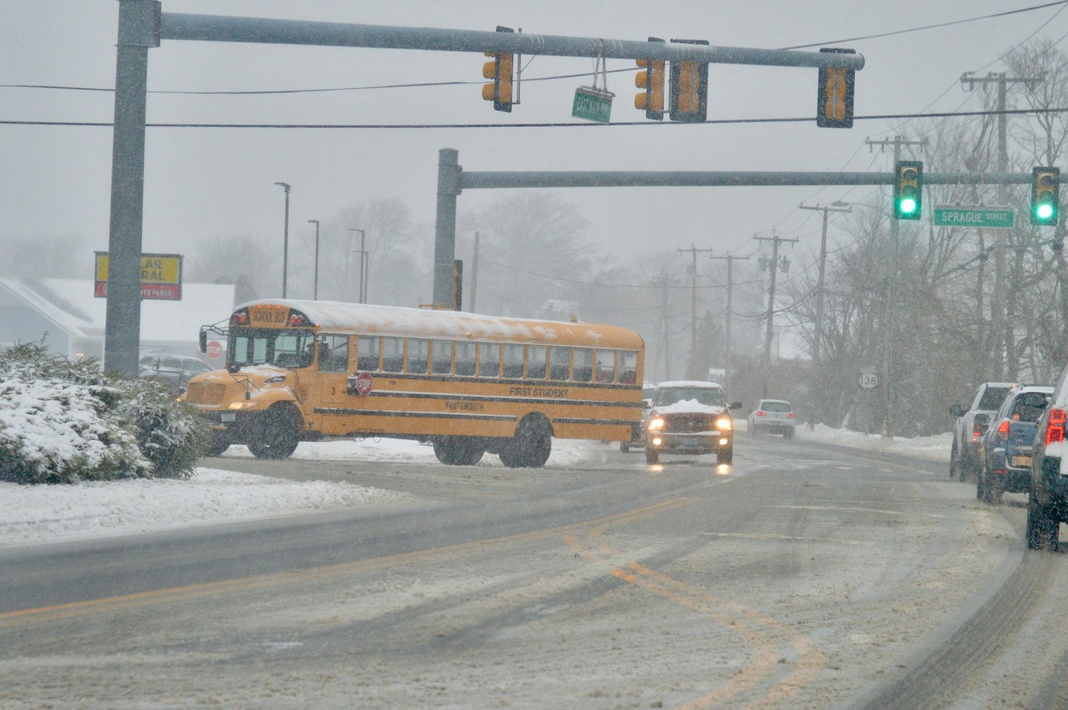 A school bus heads up Sprague Street from East Main Road around 8:35 a.m. Tuesday.