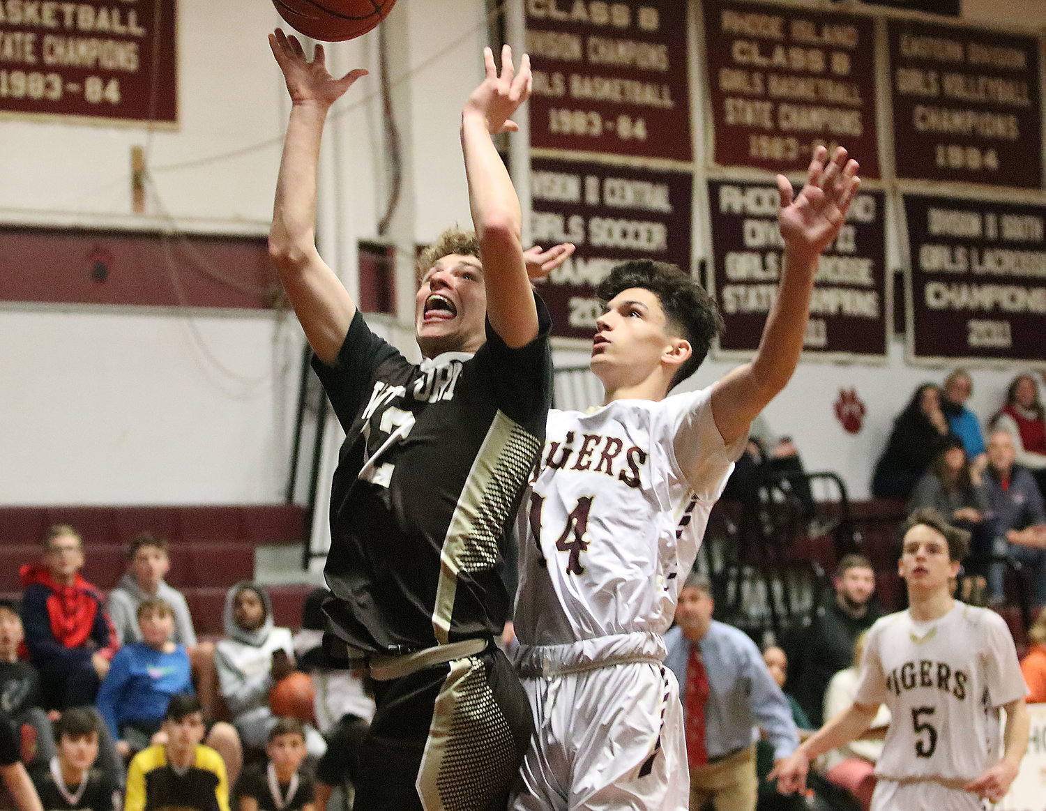 Westport guard Max Mendell goes up for a shot for the win with seconds in the game, covered defensively by Tiverton's Mason Viveiros. Mendell's shot slid off the rim as time ran out and Tiverton won the game 50-49.