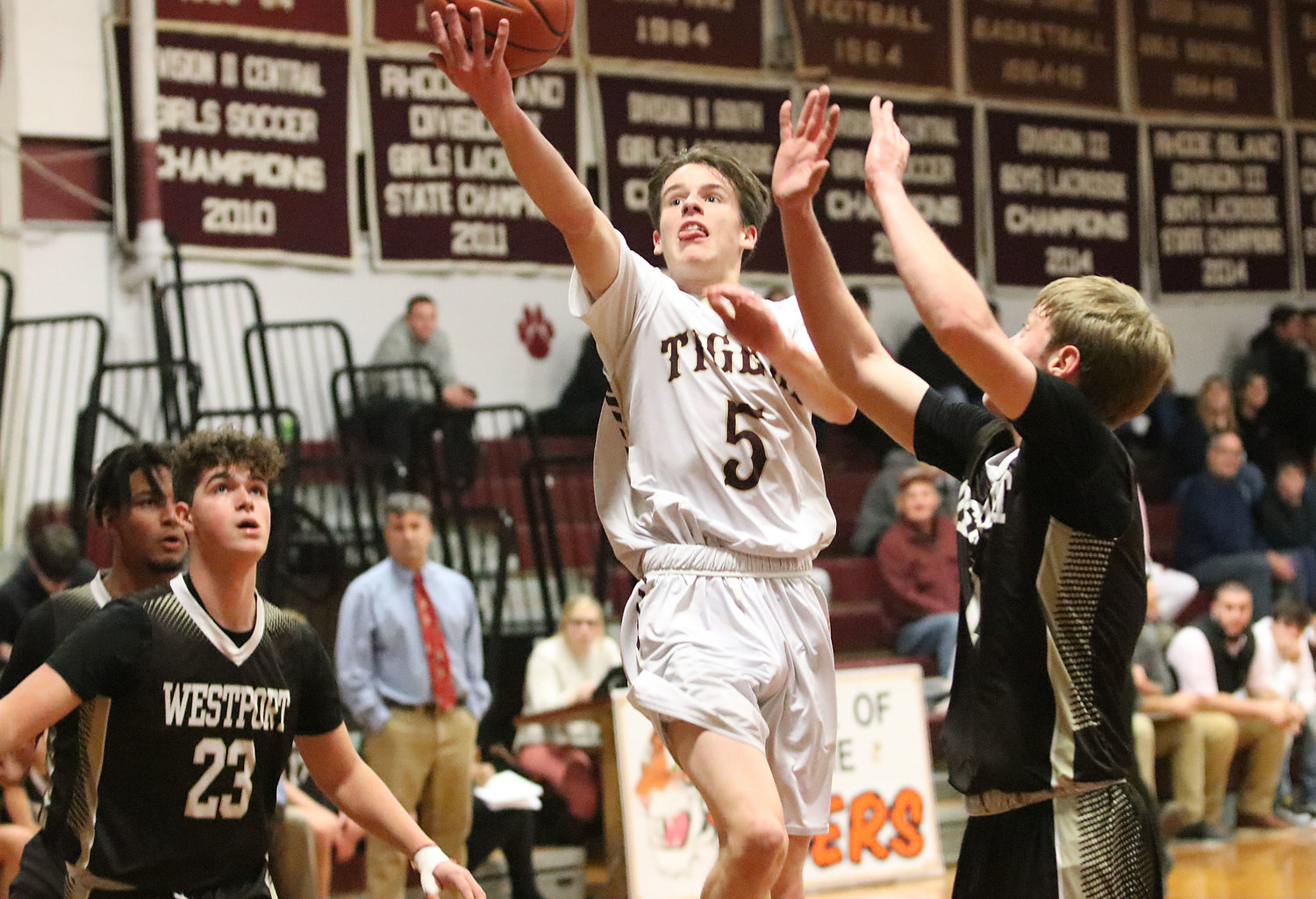 Tigers senior point guard Ryan Ennis drives for a lay up in the first half of their game against Westport at the Tiverton Holiday Tournament on Friday night. The Tigers won the game 50-49.