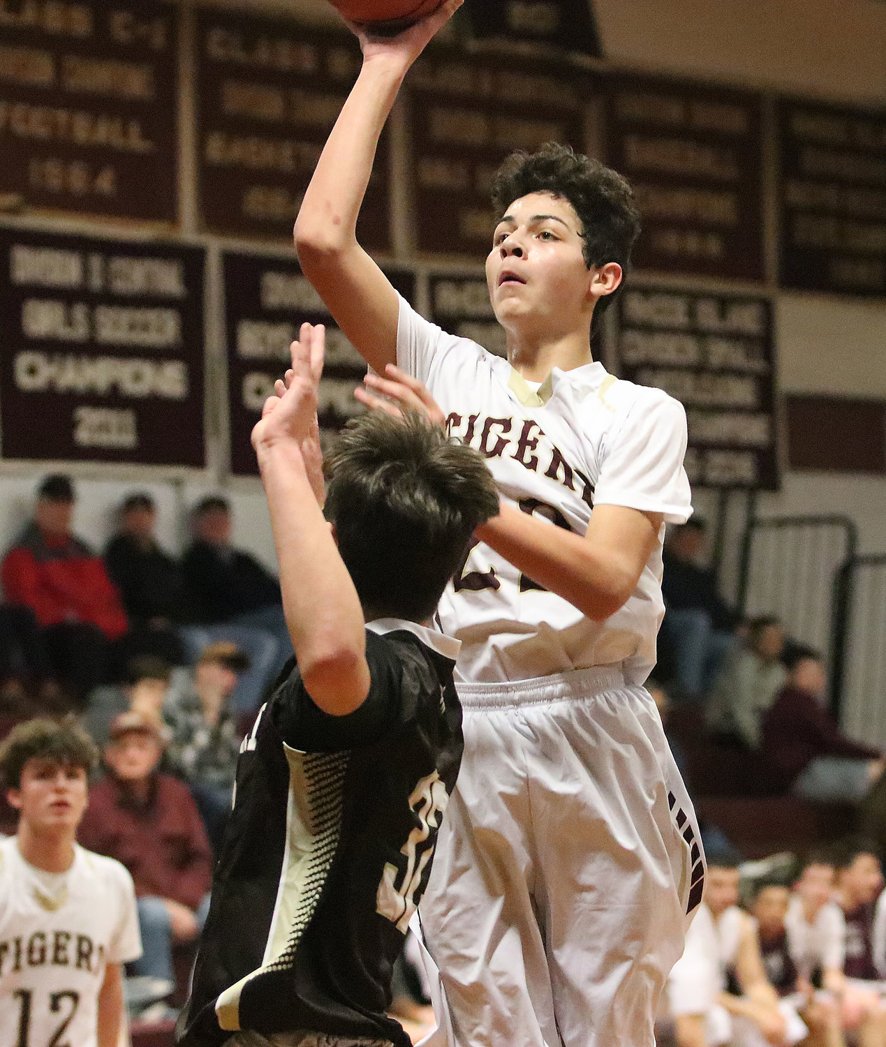 Tigers forward Nate Sama takes a jumper from inside the paint.