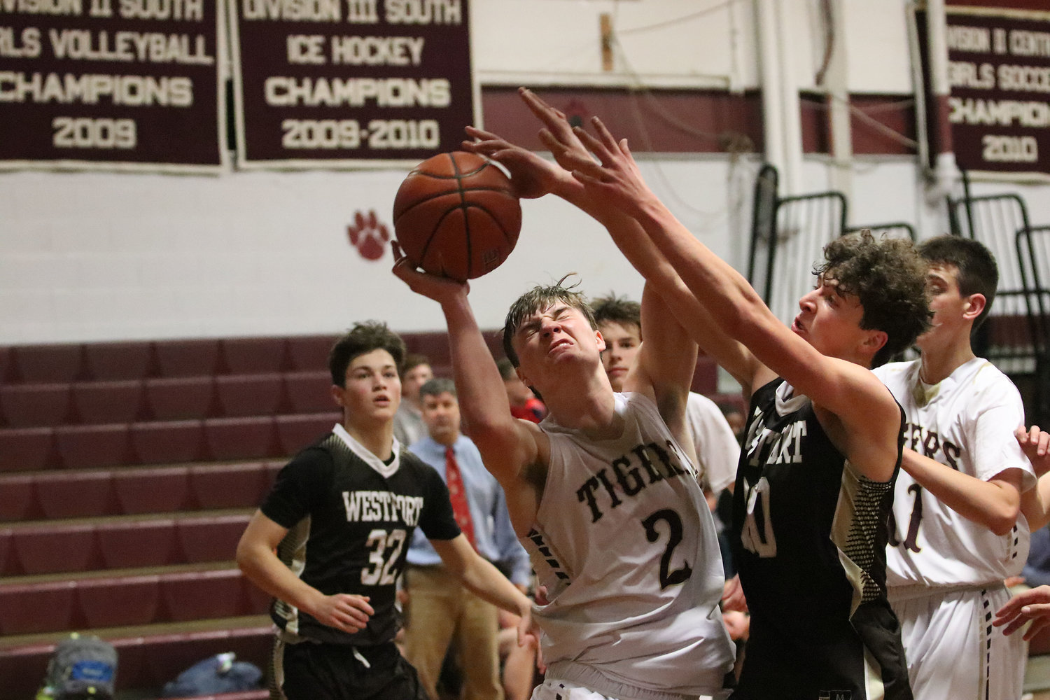 Tigers forward Matt Gacioch attempts to shoot a jumper but is heavily guarded by Westport forward Max Powers.