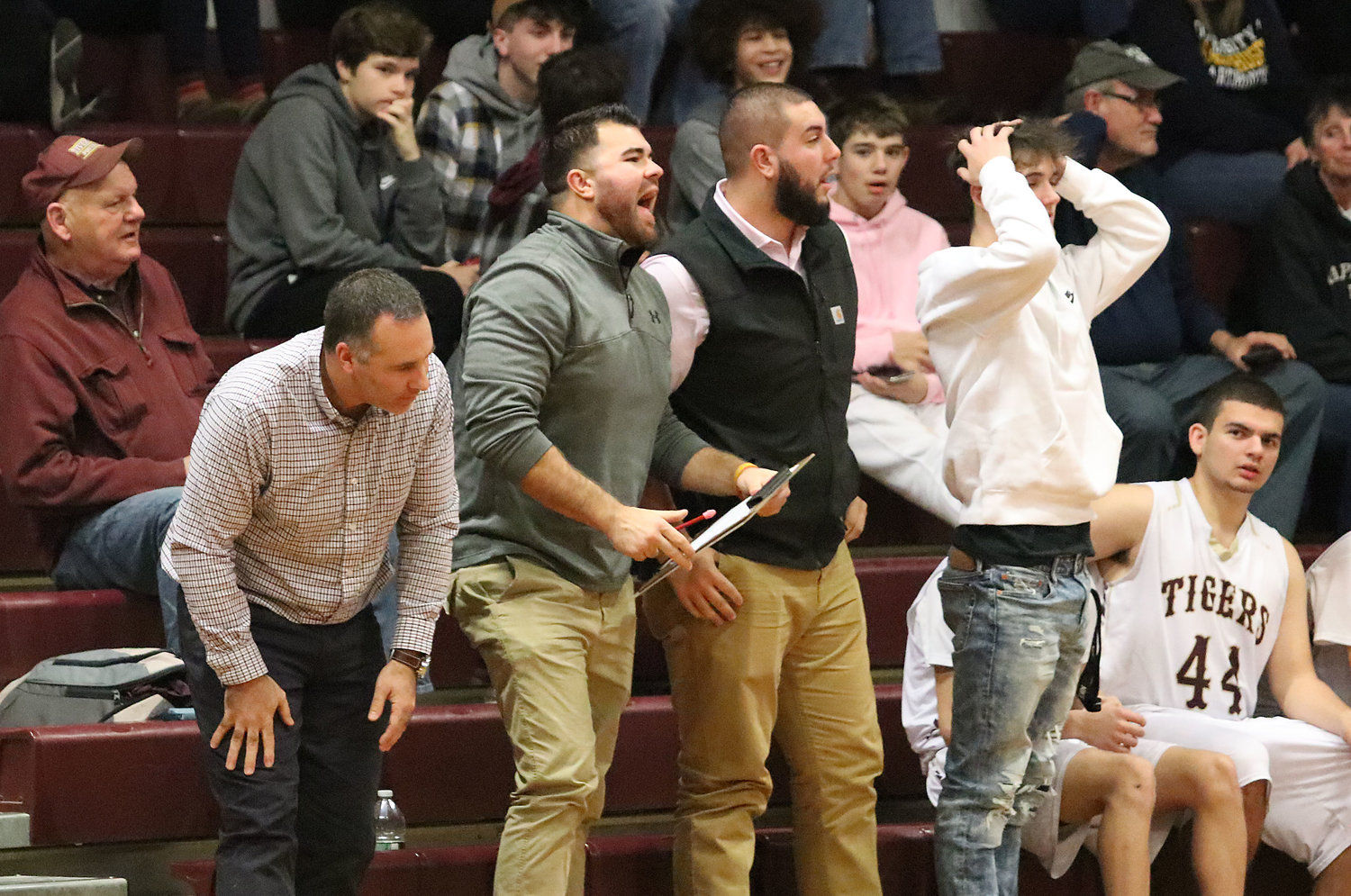 Tiverton Head Coach Dave Landoch (left) and his staff don't like a charging call by the referee in the second half.