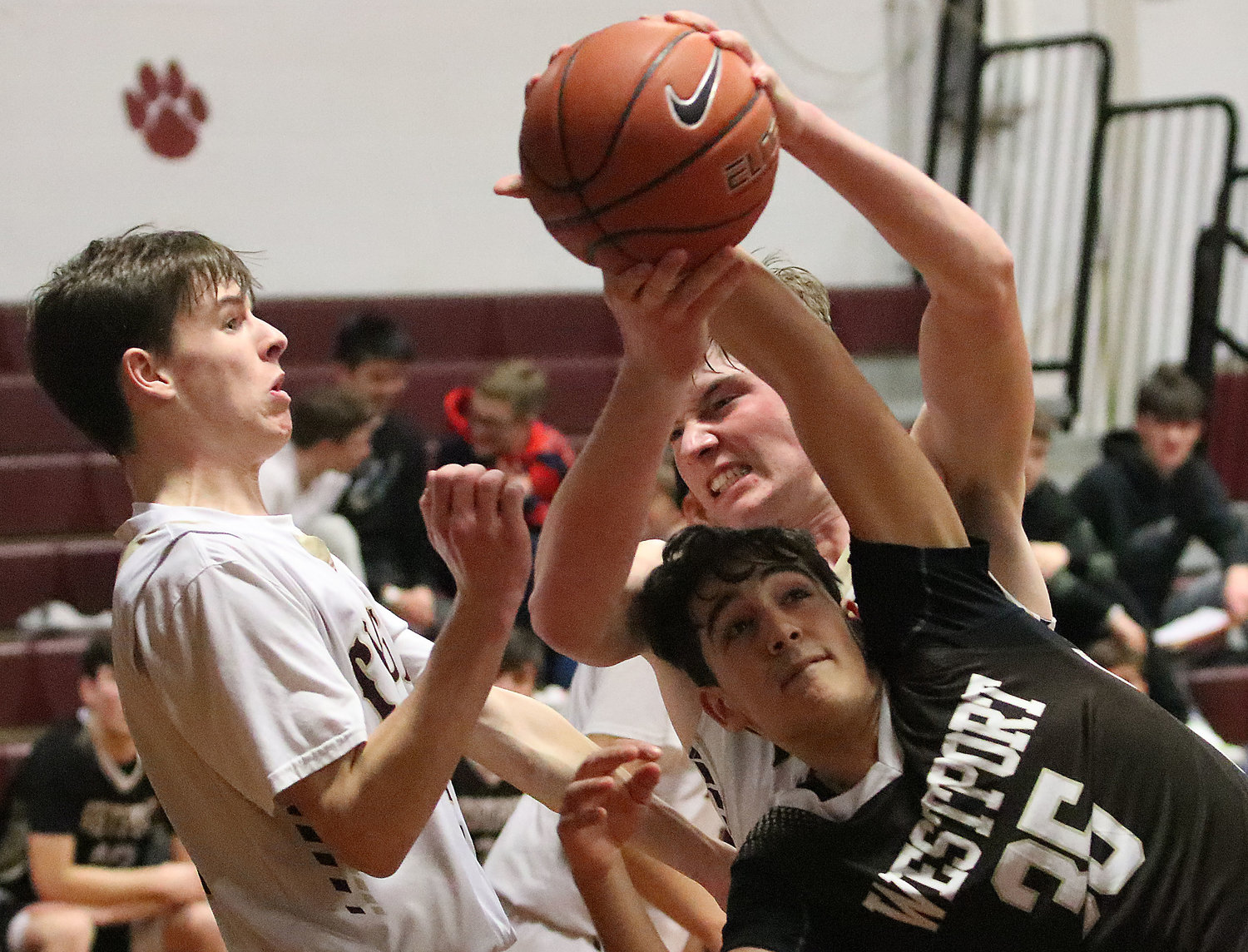 Tigers guard Ryan Ennis (left) and forward Matt Gacioch fight for a rebound with Westport forward Domanic Viterino.