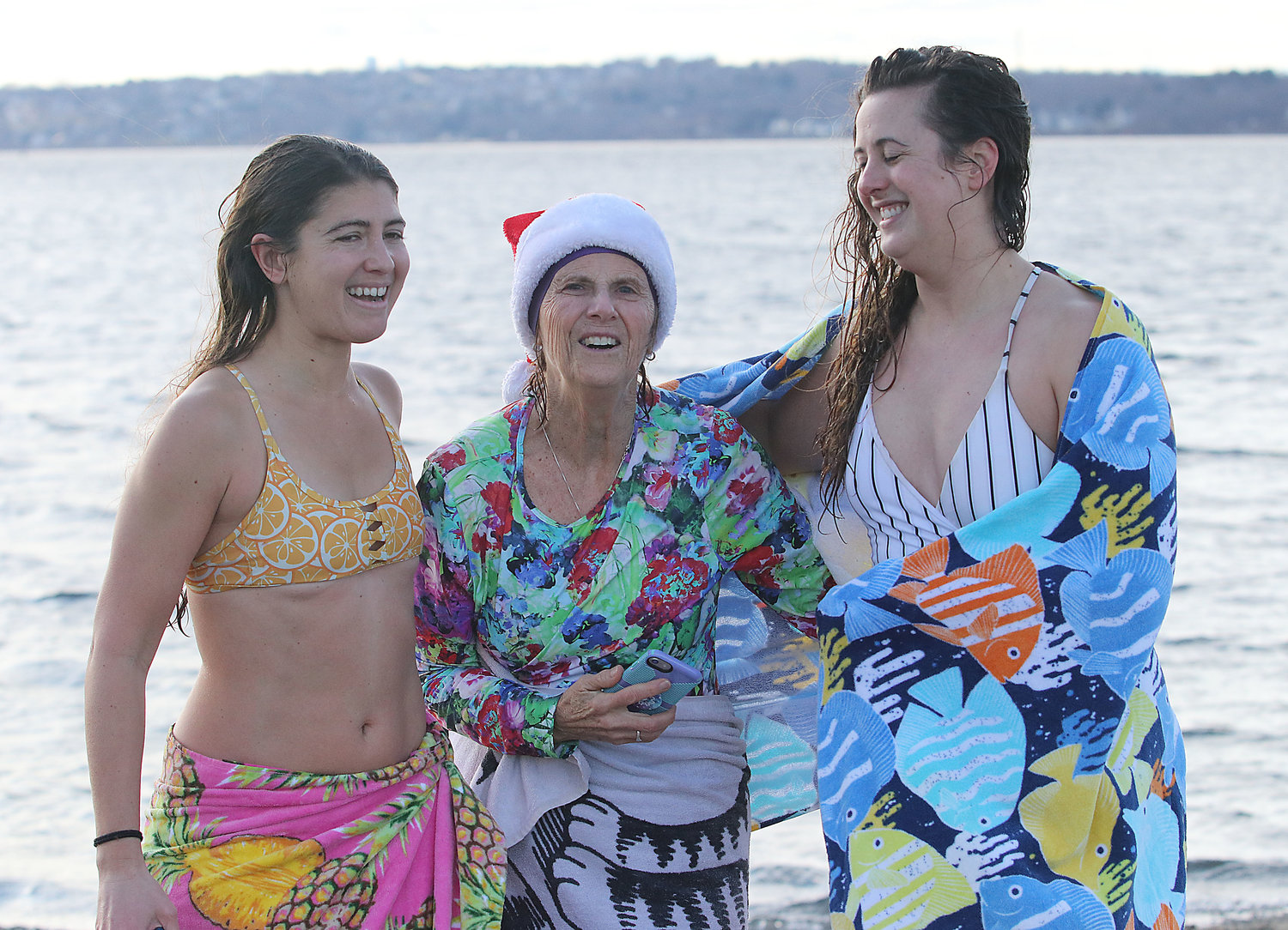 Stephanie Jones, Pam Begg and Allie Karzenski pose after running into the water Wednesday, January 1.
