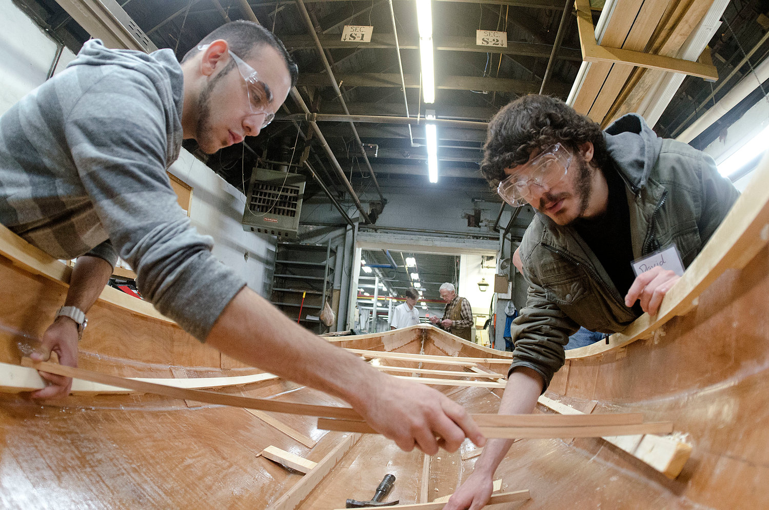 The Dharma Voyage student boatbuilding and rowing program is among this year's grant winners. Here Westport High School students work on a rowing boat.