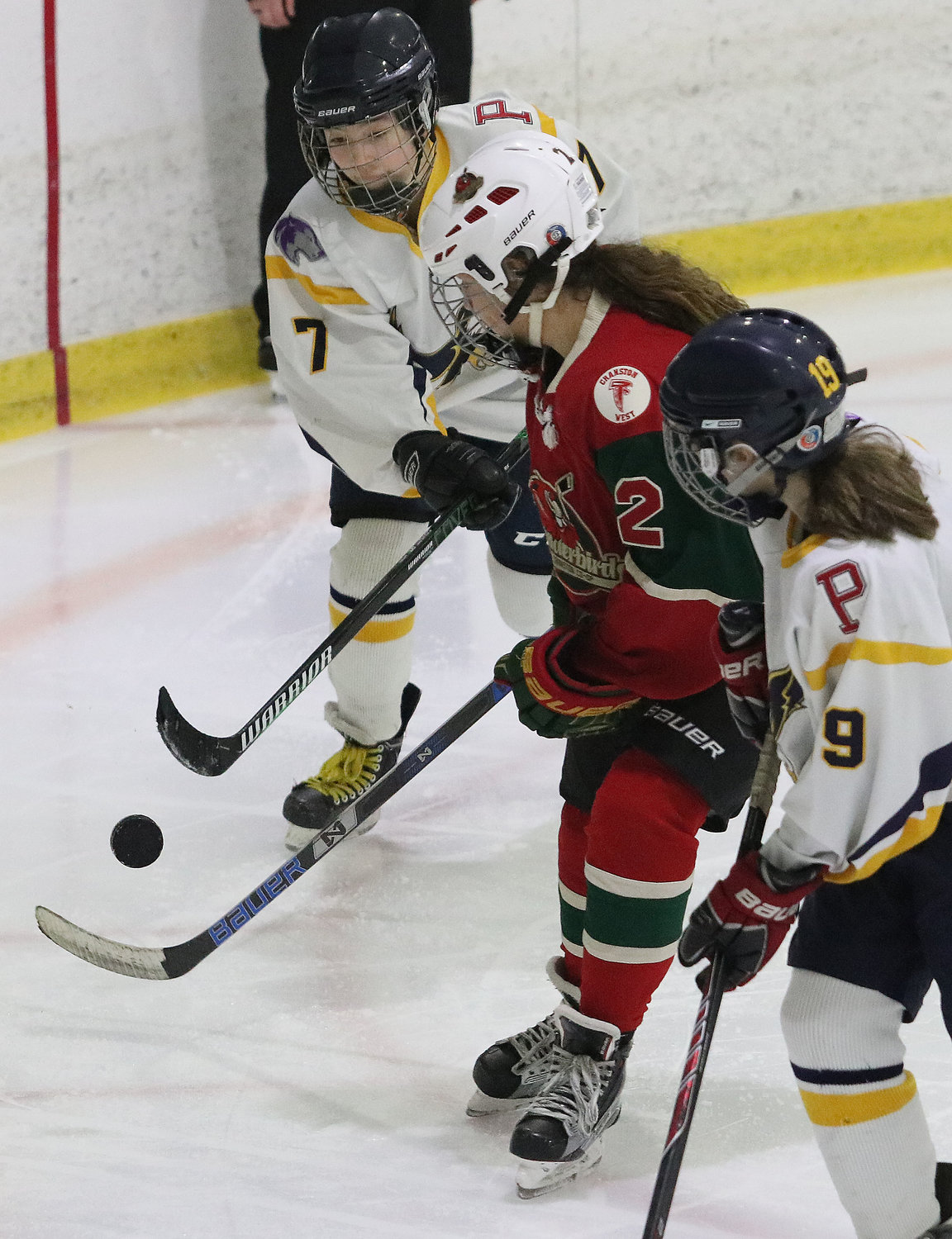 Sophomore defenseman Layla Rappleye clears the puck out of the Eagles zone during the game. Teammate Charlotte Danya is right.