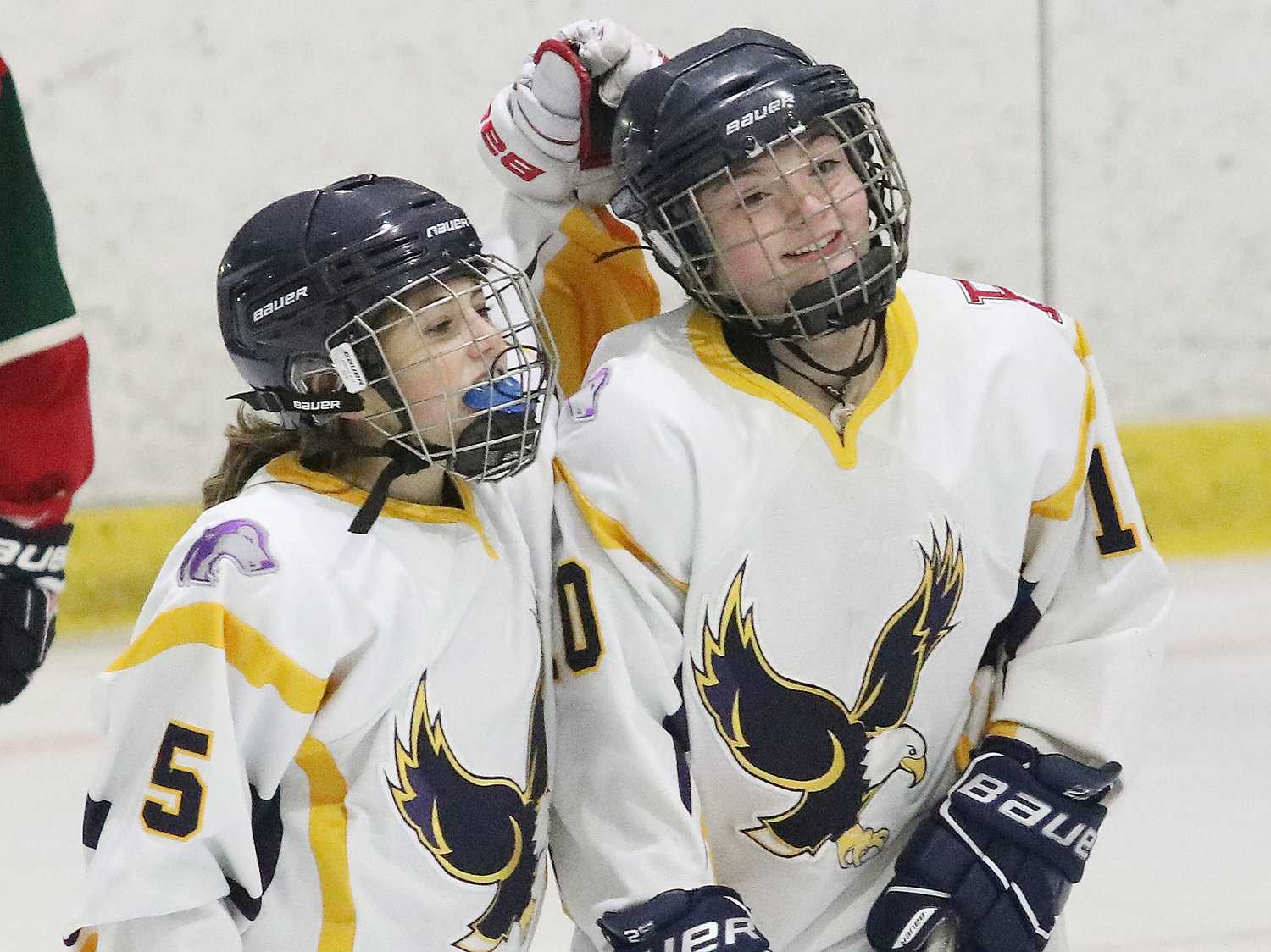 Samantha Yee (left) celebrates with Mallory Cox after Cox scored the Eagles third goal in the first period.