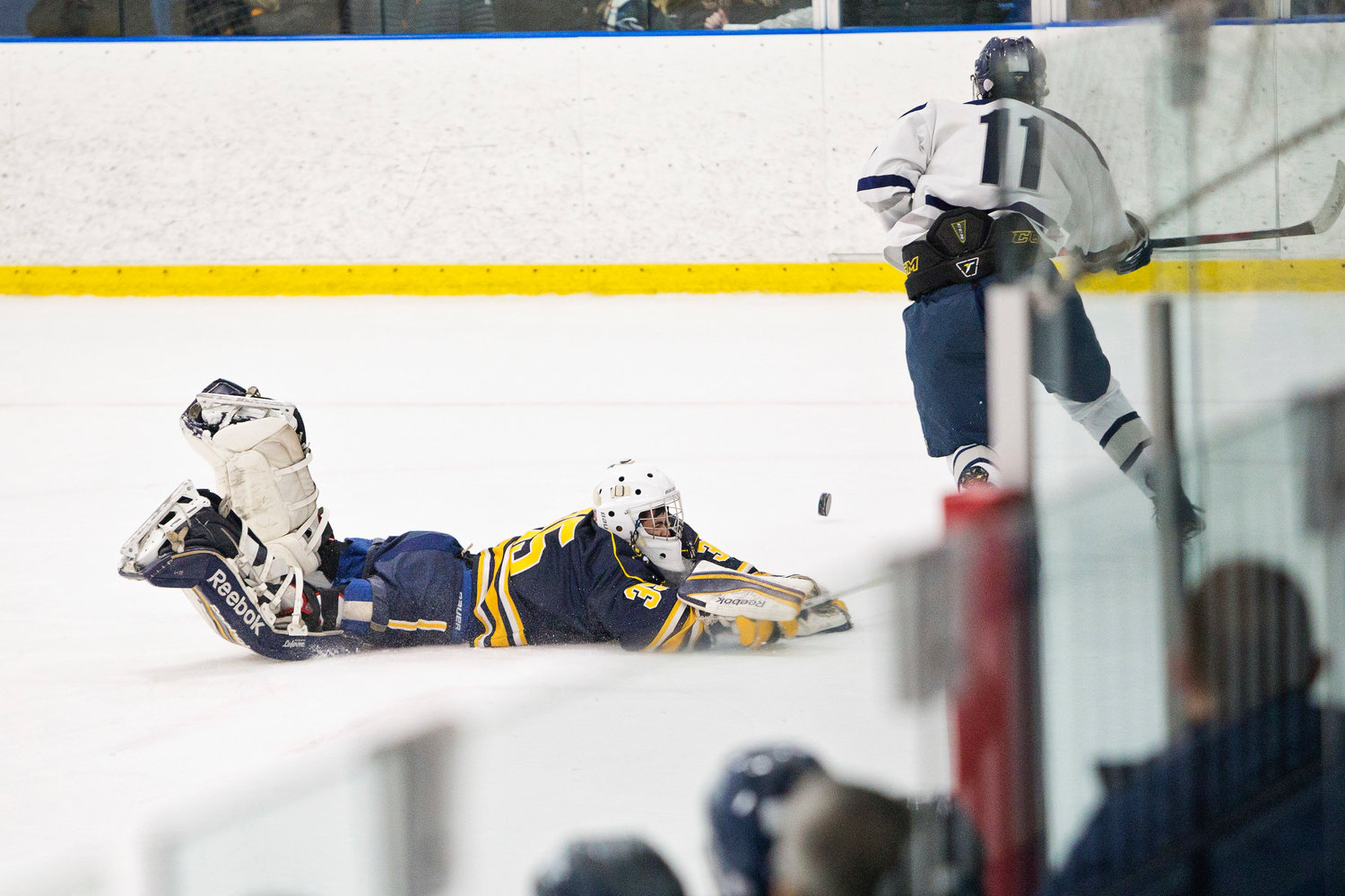 Goalie Stephen Amaral dives out of net to stop a shot by a Moses Brown/E. Providence/Tolman Co-op opponent.